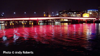 London Bridge lit up in red